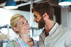 Cute couple on a date looking at each other Stock Photography