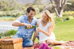 Cute couple on date pouring wine in a glass Stock Photography