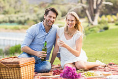 Cute couple on date pouring wine in a glass Royalty Free Stock Image