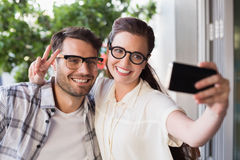 Cute couple on a date taking a selfie. At the cafe Royalty Free Stock Image