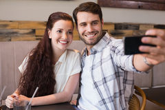 Cute couple on a date taking a selfie Stock Image