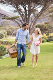 Cute couple on date walking in the park Stock Photography