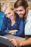 Cute couple on a date watching photos on a laptop Royalty Free Stock Image