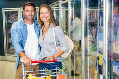 Cute couple doing grocery shopping together Royalty Free Stock Photo