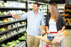 Cute couple doing grocery shopping together Stock Photography
