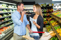 Cute couple doing grocery shopping together Stock Photos