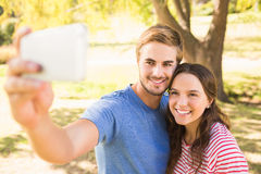 Cute couple doing selfie in the park Royalty Free Stock Images