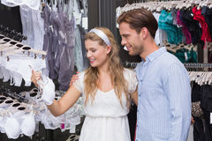 Cute couple doing shopping together Stock Images