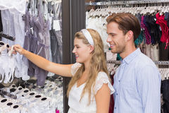 Cute couple doing shopping together Stock Photo