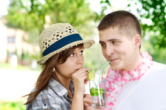 Cute couple with drink. Cute couple drinking mojito coctail Royalty Free Stock Image