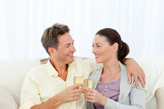 Cute couple drinking champagne Stock Photography
