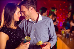 Cute couple drinking cocktails together Royalty Free Stock Image
