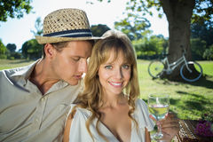 Cute couple drinking white wine on a picnic woman smiling at camera Royalty Free Stock Photos