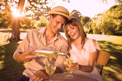 Cute couple drinking white wine together outside Stock Photo