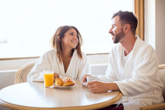Cute couple eating breakfast together Stock Photography
