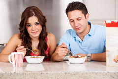 Cute couple eating breakfast Stock Images