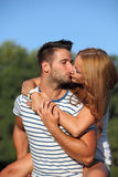 Cute couple embracing each other and kissing Stock Photography