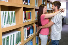 Cute couple embracing each other in the library Stock Image