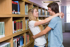 Cute couple embracing each other in the library Stock Photos