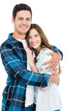 Cute couple embracing and looking the camera Stock Photography