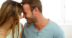 Cute couple embracing and talking together stock video