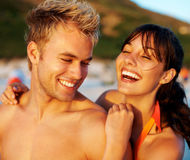Cute couple enjoying themselves at the beach Stock Photos