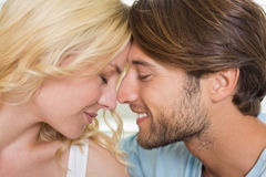 Cute couple facing each other with eyes closed Stock Images