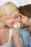 Cute couple facing each other and smiling Royalty Free Stock Photography
