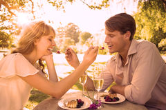 Cute couple feeding each other dessert Royalty Free Stock Image