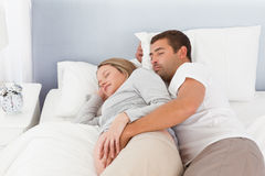 Cute couple of future parents doing a nap Stock Image