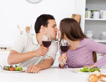 Cute couple giving a toast while having lunch Royalty Free Stock Photography