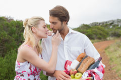 Cute couple going for a picnic about to kiss Stock Photos
