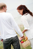Cute couple going to picnic Stock Photos