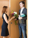 Cute couple greeting in the doorway Stock Images