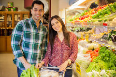 Cute couple in a grocery store Royalty Free Stock Image