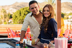 Cute couple hanging out at a bar Royalty Free Stock Photography