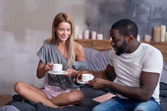 Cute couple having breakfast in bedroom together Royalty Free Stock Photo