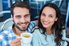 Cute couple having coffee together Stock Images