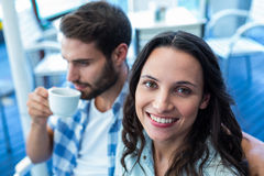 Cute couple having coffee together Stock Photos