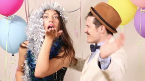 Cute couple having fun dancing in party photo booth. Cute young couple having fun dancing in party photo booth stock video footage
