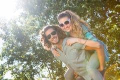 Cute couple having fun in park Stock Photos
