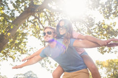 Cute couple having fun in park Stock Images