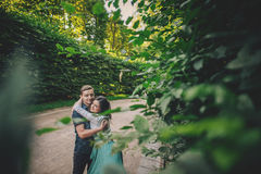 Cute couple having fun in park on a sunny day royalty free stock photo