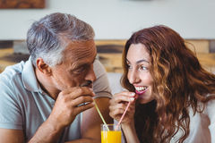 Cute couple having glass of orange juice Stock Photography