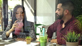 Cute couple having healthy lunch. Attractive young couple eating lunch together and having a good time stock video footage