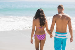 Cute couple having holidays together. Cute couple on the beach having holidays together Royalty Free Stock Image