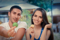 Cute Couple Having Macarons at a Restaurant Stock Photo