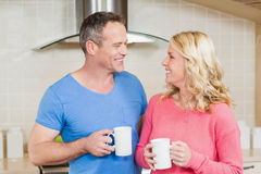 Cute couple having a mug of tea Stock Photo