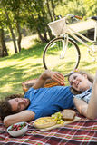Cute couple having a picnic stock photos