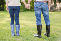 Cute couple holding hands Stock Image